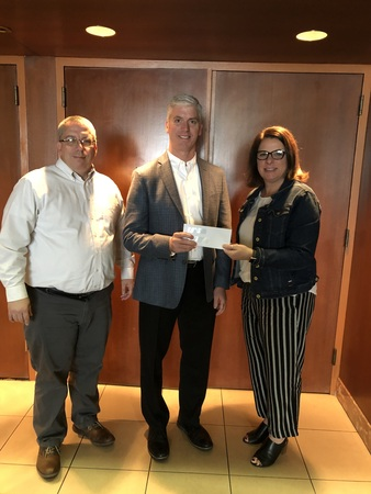 MCAO President Tim Farber thanks representatives from the MCA of Northwest Ohio John White and Anne Saloff for their generous PAC contribution.